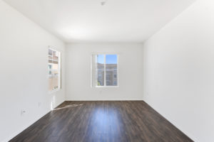bright living area with wood floors