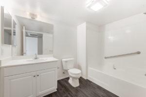wood flooring bathroom with bathtub and shower
