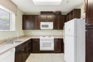 kitchen with brown cabinets and white appliances